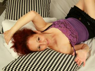 OneFlirtMadamM - Webcam live exciting with this redhead Mature